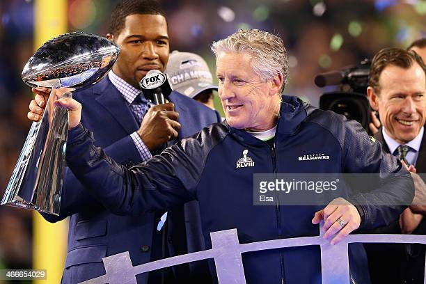 Head coach Pete Carroll of the Seattle Seahawks holds the Vince Lombardi Trophy after his team won Super Bowl XLVIII at MetLife Stadium on February 2...