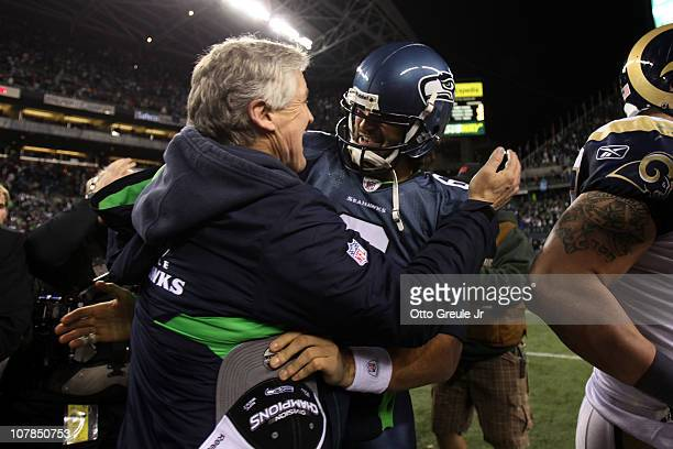 Head coach Pete Carroll of the Seattle Seahawks hugs quarterback Charlie Whitehurst after defeating the St. Louis Rams 16-6 at Qwest Field on January...