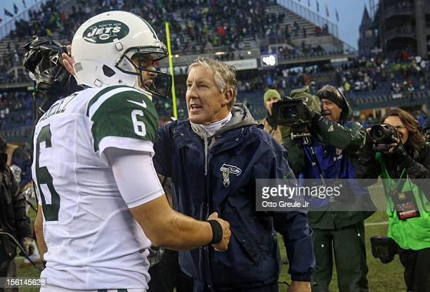 Head coach Pete Carroll of the Seattle Seahawks is congratulated by quarterback Mark Sanchez of the New York Jets after the Seahawks defeated the...