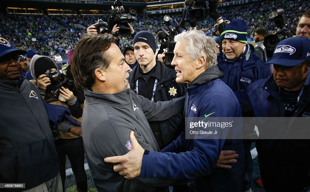 Head coach Pete Carroll (R) of the Seattle Seahawks is congratulated by head coach Jeff Fisher of the St. Louis Rams after the Seahawks defeated the Rams 20-6 at CenturyLink Field on December 28, 2014 in Seattle, Washington.