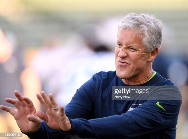 Head coach Pete Carroll of the Seattle Seahawks jokes on the field before a preaseason game against the Los Angeles Chargers at StubHub Center on...