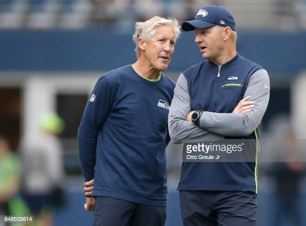 Head coach Pete Carroll of the Seattle Seahawks, left, talks with offensive coordinator Darrell Bevell before the game against the San Francisco...