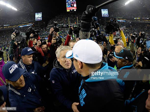 Head coach Pete Carroll of the Seattle Seahawks shakes hands with head coach Ron Rivera of the Carolina Panthers after their 2015 NFC Divisional...