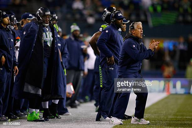 Head coach Pete Carroll of the Seattle Seahawks shouts on the field against the Carolina Panthers in the first half during the 2015 NFC Divisional...