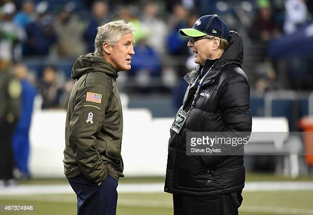Head coach Pete Carroll of the Seattle Seahawks speaks with Seattle Seahawks owner Paul Allen prior to the game between the Seattle Seahawks and the...