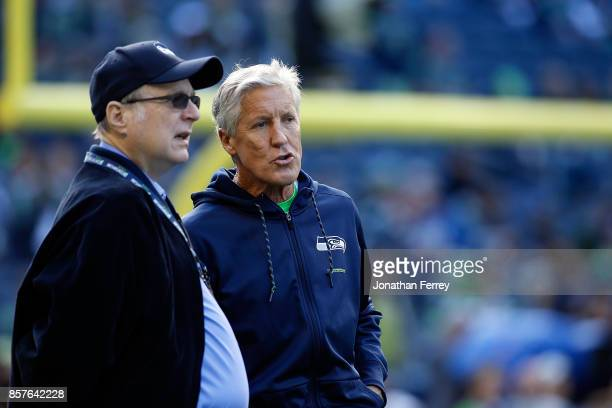 Head Coach Pete Carroll of the Seattle Seahawks speaks with team owner Paul Allen before the game against the Indianapolis Colts at CenturyLink Field...