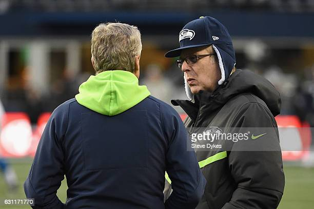 Head coach Pete Carroll of the Seattle Seahawks talks with Seattle Seahawks owner Paul Allen before the NFC Wild Card game against the Detroit Lions...