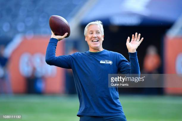 Head coach Pete Carroll of the Seattle Seahawks throws a football during warmups prior to the game against the Chicago Bears at Soldier Field on...