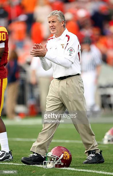 Head Coach Pete Carroll of the USC Trojans encourages his players prior to the Rose Bowl presented by Citi against the Illinois Fighting Illini at...