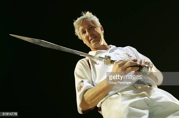 Head coach Pete Carroll of the USC Trojans holds the sword he used to direct the band after defeating the Oklahoma Sooners 55-19 to win the FedEx...