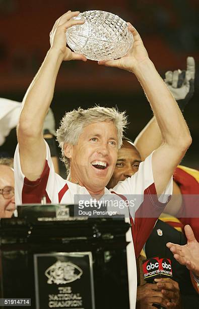 Head coach Pete Carroll of the USC Trojans holds up the championship trophy after defeating the Oklahoma Sooners 5519 to win the FedEx Orange Bowl...