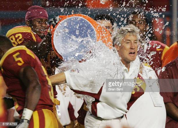 Head coach Pete Carroll of the USC Trojans is hit with the Gatorade bucket minutes before defeating the Oklahoma Sooners 5519 to win the FedEx Orange...