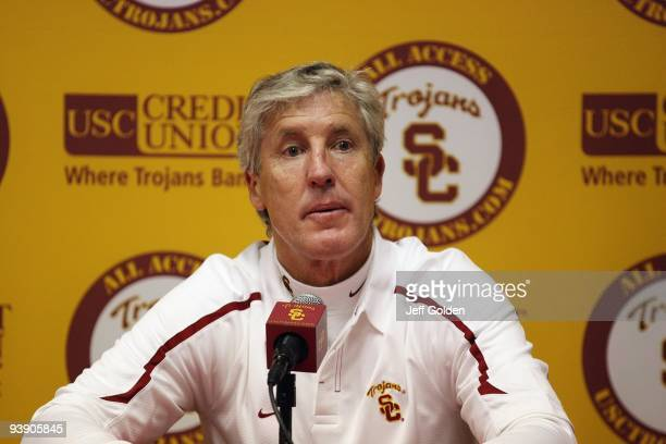 Head coach Pete Carroll of the USC Trojans listens to a question from a member of the media at a post game press conference following the game...