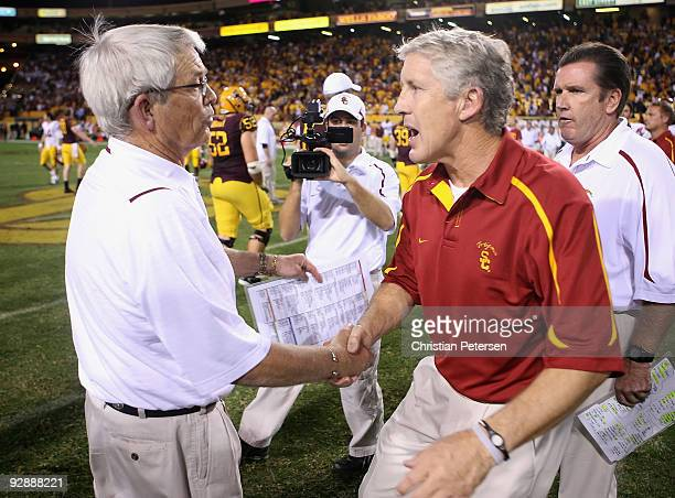 Head coach Pete Carroll of the USC Trojans shakes hands with the Dennis Erickson of the Arizona State Sun Devils following the college football game...