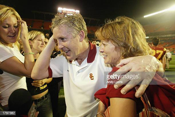 Head coach Pete Carroll of USC celebrates the victory over Iowa with wife Glena and daughter Jaime after the FedEx Orange Bowl at Pro Player Stadium...