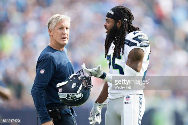 Head Coach Pete Carroll talks with Richard Sherman of the Seattle Seahawks during a game against the Tennessee Titans at Nissan Stadium on September...