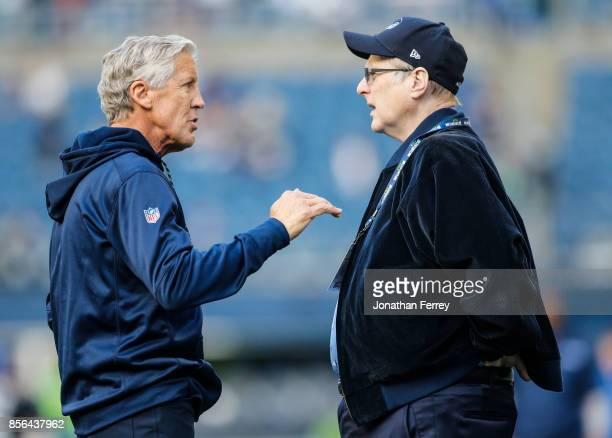 Head coach Pete Carroll talks with Seahawks owner Paul Allen on the field before the game at CenturyLink Field on October 1 2017 in Seattle Washington
