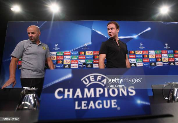 Head coach Peter Bosz and Mario Goetze arrive for a Borussia Dortmund press conference ahead of their UEFA Champions League Group H match against...