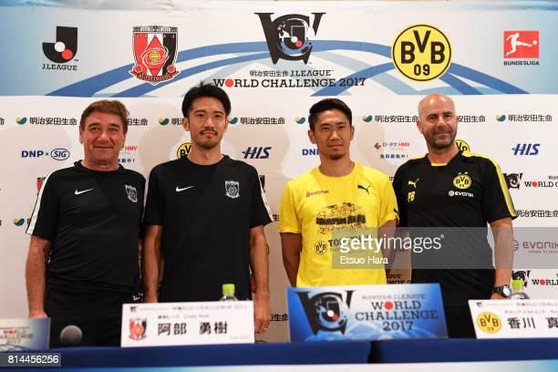 Head coach Peter Bosz and Shinji Kagawa of Borussia Dortmund and Head coach Mihailo Petrovic and Yuki Abe of Urawa Red Diamonds pose for...