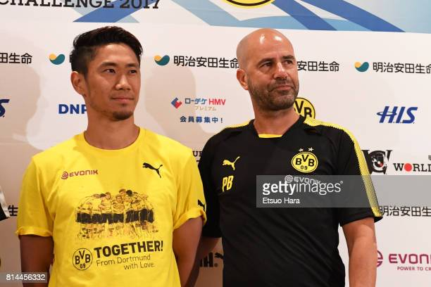 Head coach Peter Bosz and Shinji Kagawa of Borussia Dortmund pose for photographer during a press conference ahead of the friendly match against...
