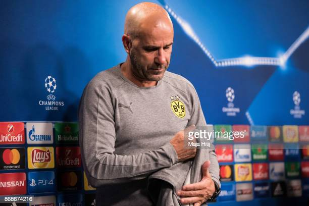 Head coach Peter Bosz of Borussia Dortmund leaves after the Press Conference prior the UEFA Champions League group H match between Borussia Dortmund...