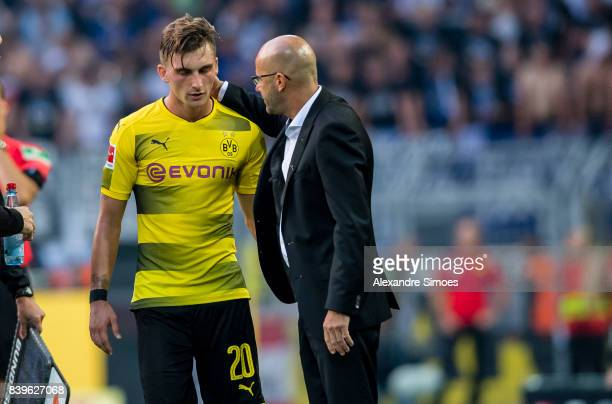 Head coach Peter Bosz of Borussia Dortmund together with Maximilian Philipp during the Bundesliga match between Borussia Dortmund and Hertha BSC at...