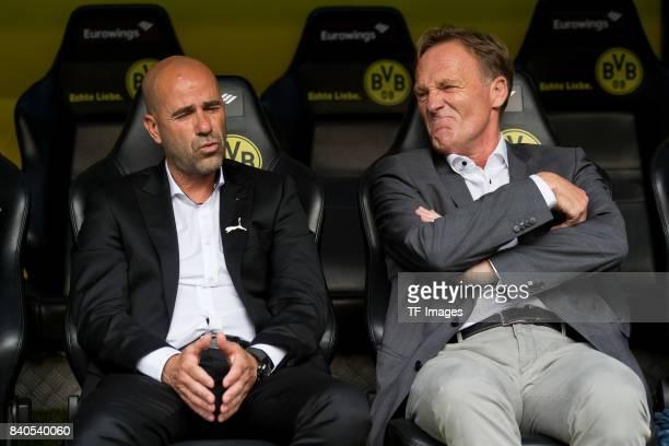 Head coach Peter Bosz of Dortmund and CEO HansJoachim Watzke of Dortmund sits on the bench during the Bundesliga match between Borussia Dortmund and...