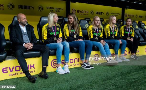 Head coach Peter Bosz of Dortmund and the U17 Handball women of Dortmund during the Bundesliga match between Borussia Dortmund and 1 FC Koeln at the...