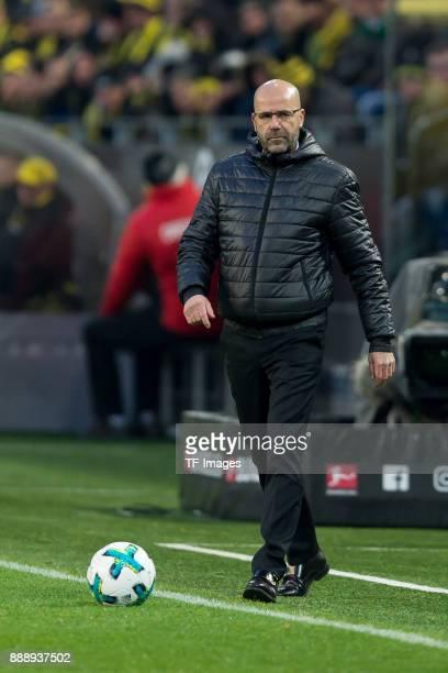 Head coach Peter Bosz of Dortmund controls the ball during the Bundesliga match between Borussia Dortmund and SV Werder Bremen at Signal Iduna Park...