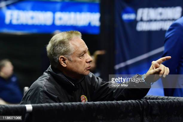 Head coach Peter Brand talks to Veronica Czyzewski of Harvard as she competes against Karolina Cieslar of St John's in the Saber semi finals during...