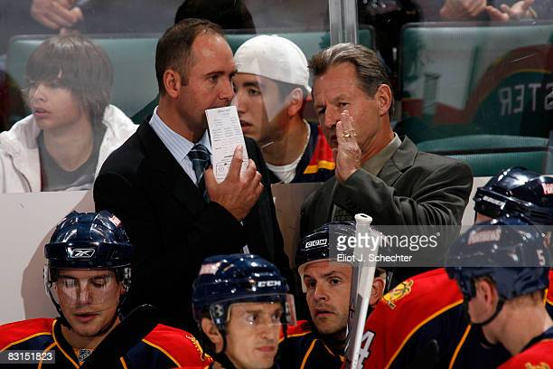 Head coach Peter DeBoer and assistant coach Mike Kitchen of the Florida Panthers talk during preseason action against the New York Islanders at the...