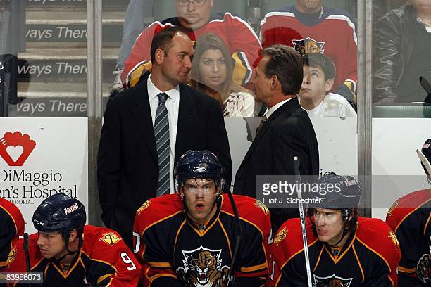 Head Coach Peter DeBoer and Assistant Coach Mike Kitchen of the Florida Panthers discuss strategy on the bench against the Boston Bruins at the Bank...