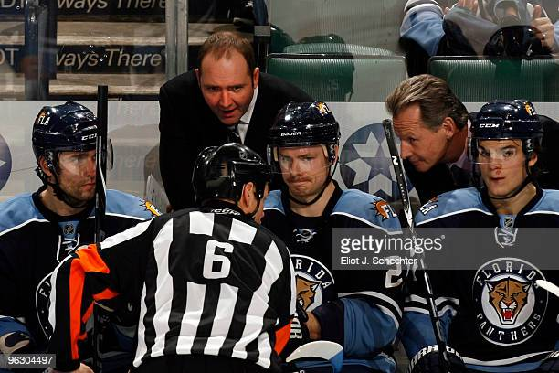 Head Coach Peter DeBoer of the Florida Panthers and Assistant Coach Mike Kitchen discuss the goal review with Referee Dan Marouelli during a break in...