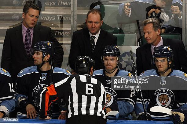 Head coach Peter DeBoer of the Florida Panthers and Assistant Coaches Jim Hulton and Mike Kitchen listen to NHL Referee Dan Marouelli after a video...