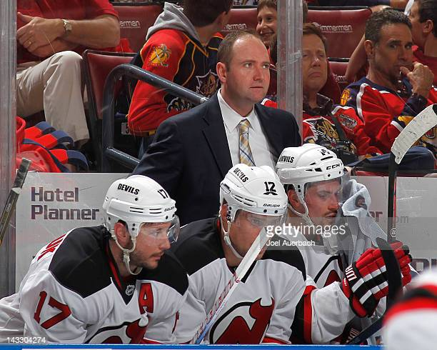 Head coach Peter DeBoer of the New Jersey Devils watches first period action against the Florida Panthers in Game Five of the Eastern Conference...