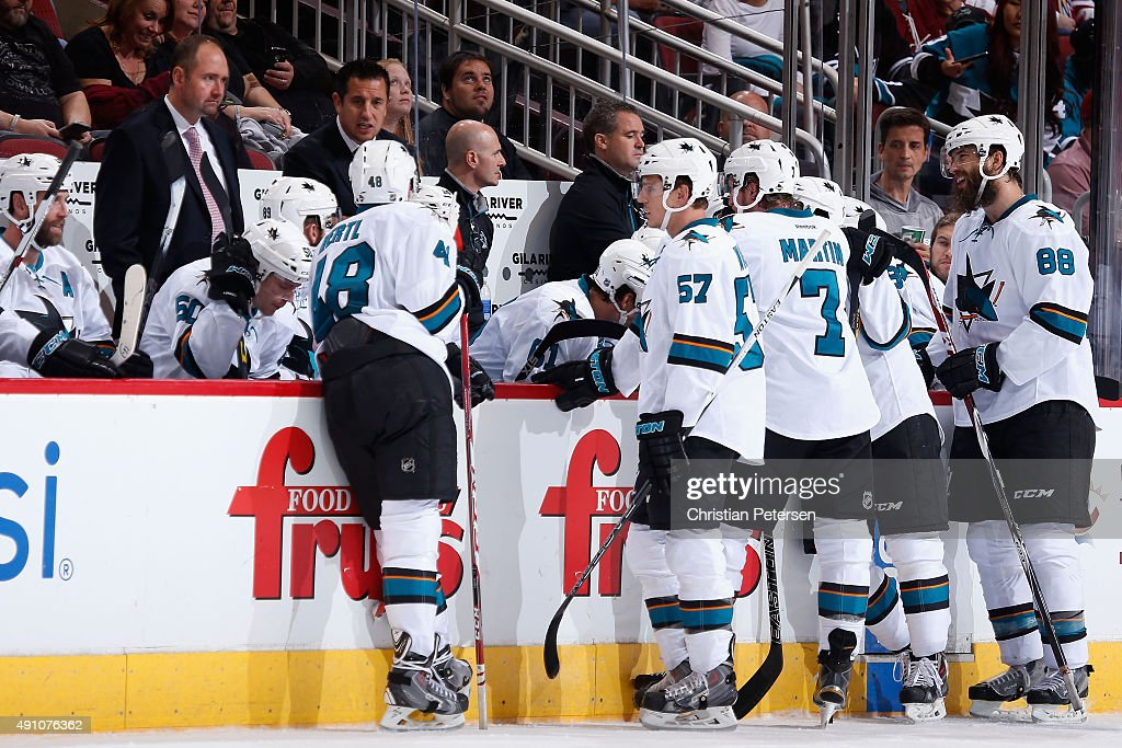 Head coach Peter DeBoer of the San Jose Sharks talks with his team during a time out in the third period of the NHL preseason game against the Arizona Coyotes at Gila River Arena on October 2, 2015 in Glendale, Arizona. The Sharks defeated the Coyotes 3-0.