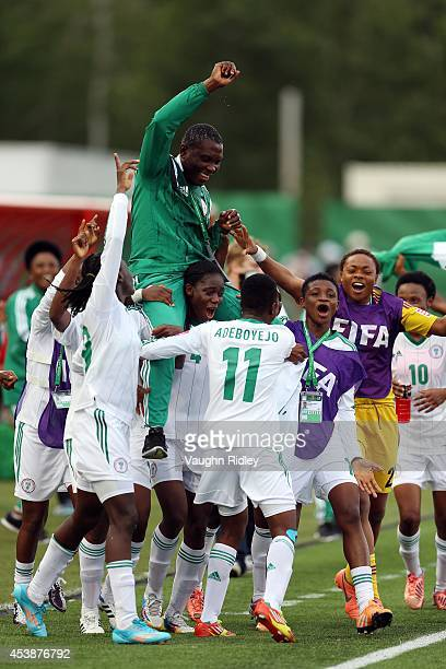 Head Coach Peter Dedevbo of Nigeria is carried on the shoulders of his players as they celebrate victory following the final whistle of the FIFA U20...