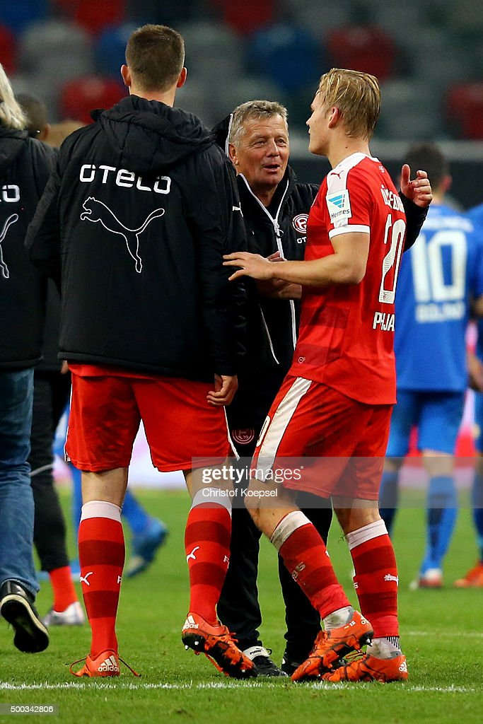 Head coach Peter Hermann of Duesseldorf celebrates with Joel Pohjanpalo of Duesseldorf who scored the decision goal during the Second Bundesliga match between Fortuna Duesseldorf and Eintracht Braunschweig at Esprit-Arena on December 7, 2015 in Duesseldorf, Germany. The match between Duesseldorf and Braunschweig ended 1-0.