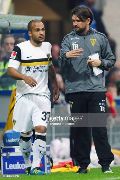 Head coach Peter Hyballa of Aachen talks to David Odonkor of Aachen during the Second Bundesliga match between SC Paderborn and Alemannia Aachen at...