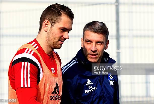 Head coach Peter Knaebel of Hamburg talks to Pierre Michel Lasogga during the of Hamburger SV training session on March 23, 2015 in Hamburg, Germany.