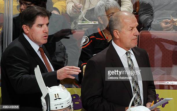 Head coach Peter Laviolette and assistant coach Kevin McCarthy of the Nashville Predators work on a play during a game against the Anaheim Ducks on...