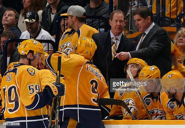 Head coach Peter Laviolette and assistant Phil Housley of the Nashville Predators coach against the Pittsburgh Penguins during the third period at...