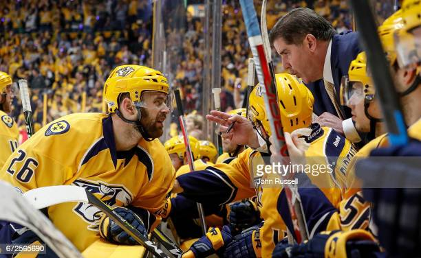 Head coach Peter Laviolette coaches Harry Zolnierczyk of the Nashville Predators during a break in action against the Chicago Blackhawks in Game Four...