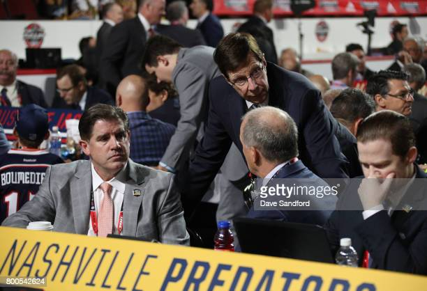 Head coach Peter Laviolette, left, and general manage David Poile of the Nashville Predators look on from the Predators draft table during the 2017...