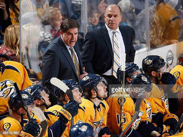 Head coach Peter Laviolette of the Nashville Predators coaches his team before overtime against the Tampa Bay Lightning during an NHL game at...