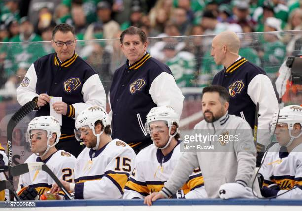 Head Coach Peter Laviolette of the Nashville Predators looks on from the bench during the first period of the 2020 NHL Winter Classic between the...