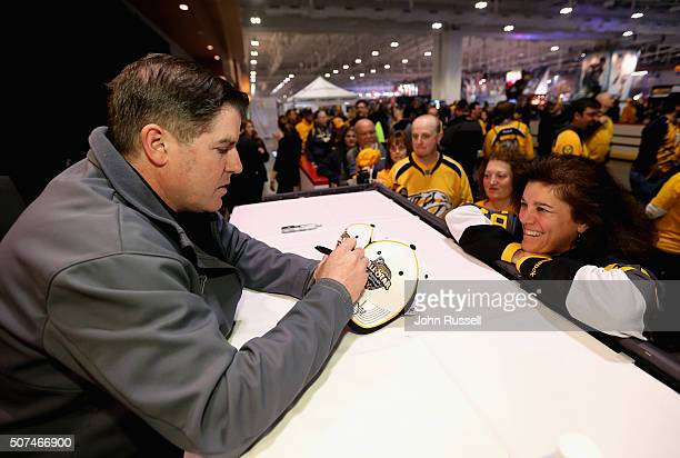 Head coach Peter Laviolette of the Nashville Predators signs autographs during day two of the 2016 NHL AllStar NHL Fan Fair at the Music City Center...