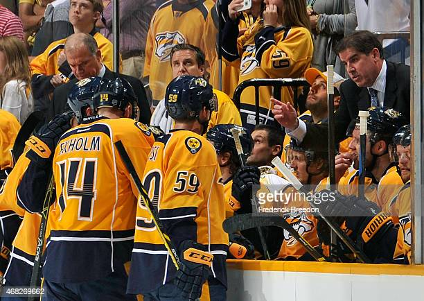 Head coach Peter Laviolette of the Nashville Predators speaks to his team during a timeout during the third period of a game against the Vancouver...