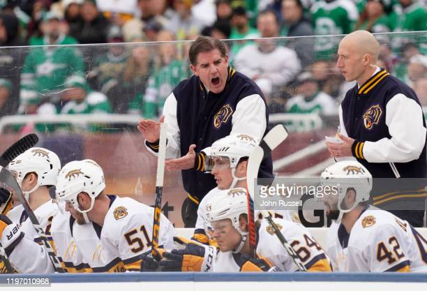 Head Coach Peter Laviolette of the Nashville Predators urges on his players in the bench area during the first period of the 2020 NHL Winter Classic...