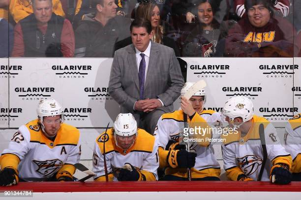 Head coach Peter Laviolette of the Nashville Predators watches from the bench during the first period of the NHL game against the Arizona Coyotes at...